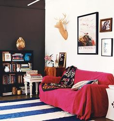 Use fabric/sheet/indian bedspread to cover couch in furnished flat. Domino Magazine, Lili Diallo