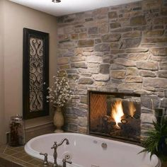 Beautiful tub and fireplace! I'd start taking baths for this!   Photo from: I love creative designs and unusual ideas (Facebook).