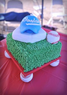 baseball cake, buttercream grass, mmf homeplate, rkt hat and ball covered in mmf.. cake stand is a painted board with baseballs glued to the 4 corners