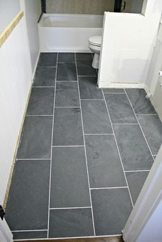 How to tile a bathroom with dark gray slate 12x24 tile - isn't it gorgeous!