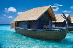 The luxurious bungalows at COMO Resort on the private Cocoa Island (known locally as Makunufushi) in South Male Atoll, Maldives. These overwater-bungalow suites are built in the style of traditional Dhoni, the wooden boats used by local fishermen. #travel #unique #hotel