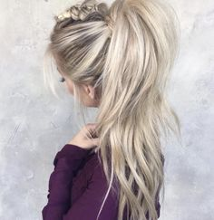 Teased, messy mohawk braid pulled into a high ponytail. Obsessed with this hairstyle.
