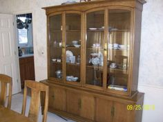 table, six chairs, china cabinet and low buffet, $700