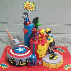 A Four years old Birthday wish to have all his favorite Superheroes on his cake. Major fun in doing all the stunning 8 characters. We added a small toy motor on the top level to allow the signage to rotate.and small LED lights for Iron Man eyes to. Birthday Cakes For Men, Cakes For Boys, Avengers Birthday, Superhero Birthday Party, Boy Birthday, Cake Birthday, Marvel Cake, Marvel Avengers, Batman Cakes