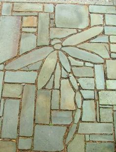 Stone dragonfly on patio.