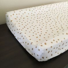 Gold metallic dot changing pad cover gold contour pad by NoniandV