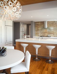 backsplash wood cabinets & white (slightly more cream & waterfall style) counters not this vent