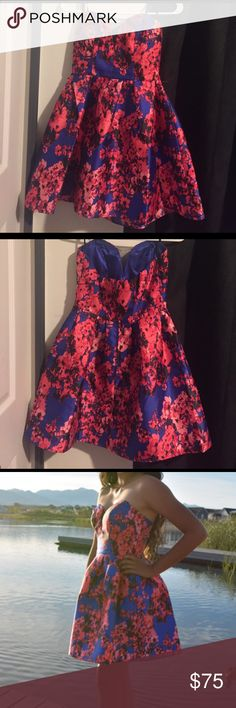 Strapless blue and pink homecoming dress Beautiful blue strapless dress with pink/red flowers. Perfect for homecoming or any other occasion! Size 5/6 fit me perfect and I am about a size s/m B Darlin Dresses Strapless
