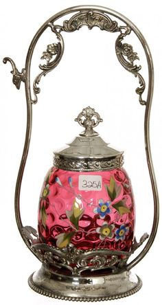 "9 1/2"" PICKLE CASTOR: CRANBERRY ART GLASS INSERT WITH ENAMEL FLORAL DECOR SET ON CUTE HOMAN SILVERPLATE FRAME"