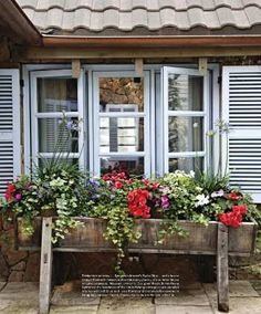 House Beautiful Paint trim, shutters and a pop of red really add character