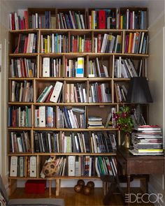 In Christopher Gow and Henrique Faria's guest-room, the bookcase is made from pine shelving and cardboard boxes.