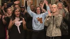 Kyle Mooney rocking an ALF sweater between Kerry Washington & Eminem; in background, Seth Meyers waves awkwardly, Kate McKinnon looks no more or less confused than she usually does during Goodnights Kyle Mooney, Seth Meyers, Kate Mckinnon, Kerry Washington, Saturday Night Live, Snl, Like A Boss, Eminem, Confused