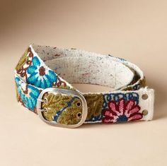 """Embroidered flowers are always in season and perfect with jeans. And just as with every flower, each handmade belt varies slightly. Wool. Imported. Exclusive. Sizes S (23"""" to 31""""), M (28"""" to 37""""), L (34"""" to 43""""). 2""""W."""