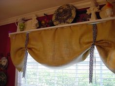 made with burlap and ribbon - going to do this in my sunroom when I redo it soon