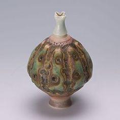 Love this porcelain minature! By Geoffrey Swindell