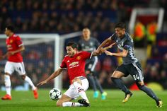 Diogo Antonio Cupido Goncalves of Benefica tackles Matteo Darmian of Manchester United during the UEFA Champions League group A match between...