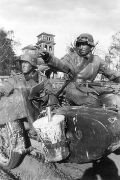German motorcycle troops. Note the bucket of whitewash attached to their sidecar.