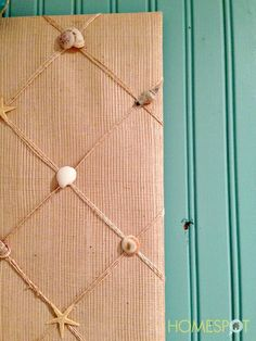 Bulletin board made from a burlap sack with seashells