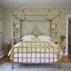 "The Colefax & Fowler ""Fuchsia"" wallpaper inspired the restful color scheme. The gold-leaf canopy bed was created by homeowner and designer A..."