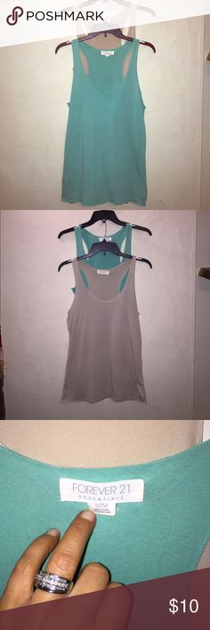Set of Forever 21 Tanks size medium Set of Forever 21 Tanks. Both size medium. One is coral green the other is tan in color. In good condition. The green one does have some wear on front as pictured in 4th picture. Keep in mind that it's up close and when worn you can't tell of the wear. Forever 21 Tops Tank Tops