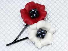These cute leather poppy bobby pins are approximately 1.75 in. Each flower has beaded crystal center. Each flower wii look slightly different due