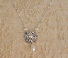 Vintage Bridal Necklace, Rhinestone Flower & Pearl Necklace, Wedding Jewelry, Sterling Silver Chain, Bridesmaids Jewelry, Emily Collection. $49.00, via Etsy.