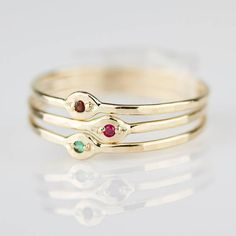 Three Solid Gold Tiny Evil Eye Rings with Emerald Ruby Garnet