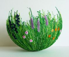 How cool is this?!  It's a bowl made out of threads! Would be cute to do for Easter just add a little stuffed bunny.