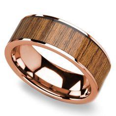 An inlay of reused teak wood adorns this 8-millimeter rose gold men's wedding band.
