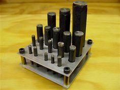 A metal holder for the transfer screw sets.