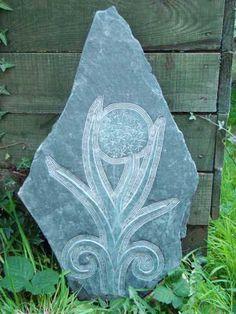 Hand carved Aberllefenni Slate (Welsh slate) #sculpture by #sculptor Jon Evans titled: 'Onion in Flower (Welsh Slate Bas Relief panel Carvings)'. #JonEvans