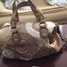 Coach Purse Only used once, in excellent condition! No rips or stains. Gold, Silver and brown. Has long strap for over the shoulder wear. Coach Bags Satchels