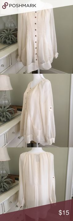SALE! Grace Elements Sheer Cream Blouse This sheer, cream, button down blouse from Grace Elements features a pin tucked front, deep pockets, and pearlescent buttons. Long sleeves can be rolled up and secured to create 3/4 sleeves. Note brown mark near right cuff buttons and small mark on sleeve. Hardly noticeable when worn and impossible to see when sleeves rolled up. Size: Large. Grace Elements Tops Blouses