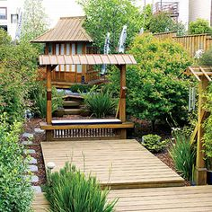 David Polifko transformed his backyard with three decks of different sizes, at three different levels.  A deck also wraps around an 8-feet-square teahouse, angled to fit a tight corner