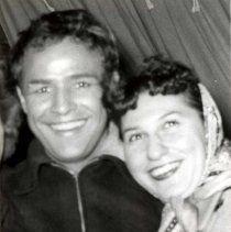Digital image of b+w photo of Marlon Brando and Eleanor Armenio [Saldinari] outside Vandenberg's Tavern, 314 River St., Hoboken, 1953. - Print, Photographic #Brando