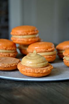 Pumpkin Pie Macarons Recipe ~ Says: The frosting is much like a buttercream. Though it contains no butter. It's simply pureed pumpkin whipped with powdered sugar and pumpkin pie spice. Easy peasy!