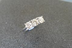 18ct white gold diamond three stone ring set with 3 brilliant cut diamonds, weighing a total of 1.27ct, I colour and VS clarity.  Set in a simple four claw setting and a plain band. Ring size N.  Valued at £2300