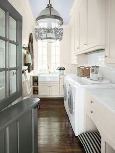chic laundry room complete with Dutch Door and dog bed!