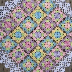 Continuing with a pretty edge around my flower squares  A really Summer doily  #crochet_millan  Design