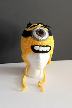 finally they are here.. Minion hats WITH ear flaps!! :)    made with acrylic yarn      S- Infant ( 0-6m)  M- Toddler ( 6-18M)  XL - Child(