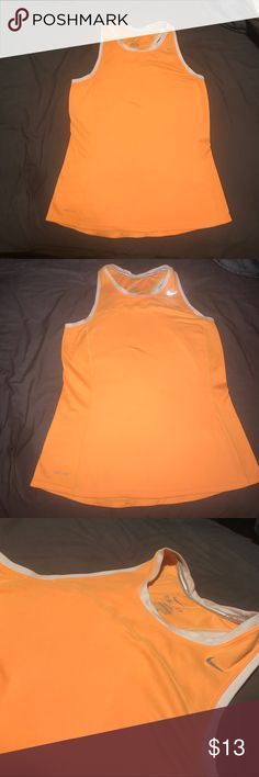 Nike shirt (orange) Super cute & comfy Nike shirt. Only worn a couple times. A little bit of discoloring on the back where the white band is. There is 2 pictures to show it. Other than that it is in great condition. No color fading. Can probably fit between a small and a medium Nike Tops