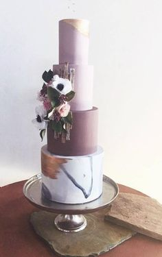 Elegantly rustic four tier purple wedding cake; Featured Cake: Hey-There Cupcake!