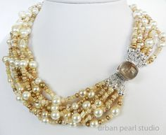 Layers of Gold in this Statement Pearl Multi Strand Necklace by UrbanPearlStudio, $145.00