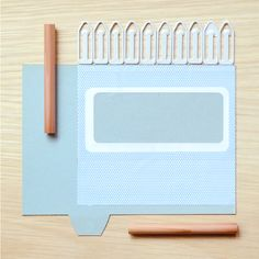 Paperclips, pencils, index card, envelope liner.