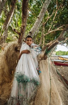 A young fisherman in Jontona village, Lembata is tidying his nets. Girls Dresses, Flower Girl Dresses, Beautiful World, Wedding Dresses, Fashion, Flowers, Dresses Of Girls, Bride Dresses, Moda