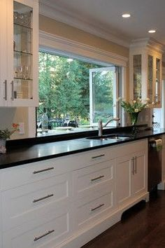 Kitchen window opens right up onto outdoor eating bar