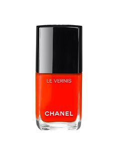 Chanel Le Vernis in Espadrilles I'm normally not an orange nail-polish type of girl. In fact, I'm not really a colorful nail-polish girl in general. But Chanel's new fiery-orange lacquer is practically screaming to be painted on fingers and toes this summer. It's got a good amount of red in it, so rather than being the color of a traffic cone, it reminds me of the rich, hot glow of a fiesta light.