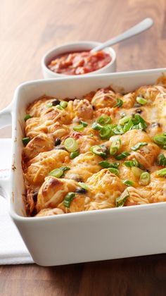 There's nothing like cheesy, saucy enchiladas to get your kids to perk up for dinner — and this chicken enchilada bake is a fun twist on a family-favorite Mexican recipe. With only 15 minutes of prep time, it's a casserole that's almost too easy.