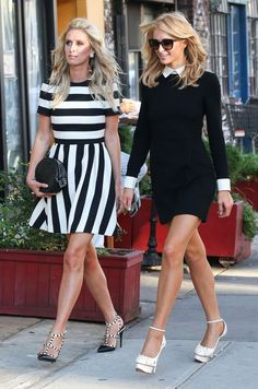 Sisters Paris and Nicky Hilton spotted out and about in New York City, New York on September 15, 2015. The pair were wearing dresses from Nicky's clothing line.