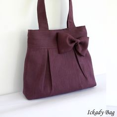 I got this purse in a Taupe color with specs of gold for the summer. I love it, and the canvas bow